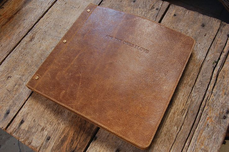 """This gorgeous photo album is handcrafted with distressed leather and vintage looking paper. Cover is embossed with the words """"For The Ones I Love."""" There are 50 pages - each one has a beautiful quote and a 4"""" X 4"""" opening to slide your photo in."""