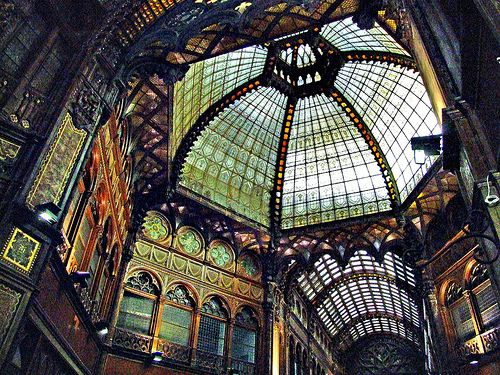 The Párisi Udvar in Budapest, Hungary. Arcade/department store/ galleria built 1907-1913, in a mix of styles- venetian gothic, orientalism, jugendstil, renaissance.