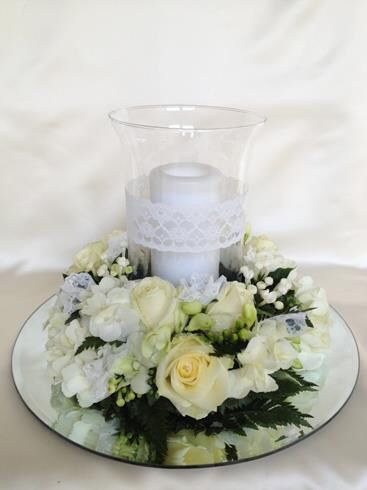 Cream roses and Orchids hurricane vase centre piece. Chanan's Floral Events