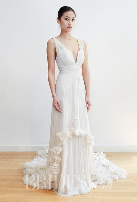Brides.com: . Chiffon sheath with plunging neckline and floral appliqués at the hem, Leila Hafzi