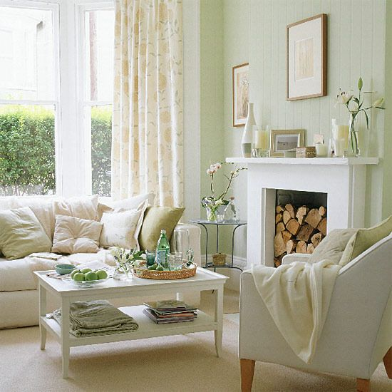 Spring living room  A few floral details like simple pictures and fresh flowers will revive a plain room. Mix a neutral sofa from Sofa Workshop and furniture with chalky green walls and a floral curtain fabric from Laura Ashley. Add details with a textured throw and silk cushions.