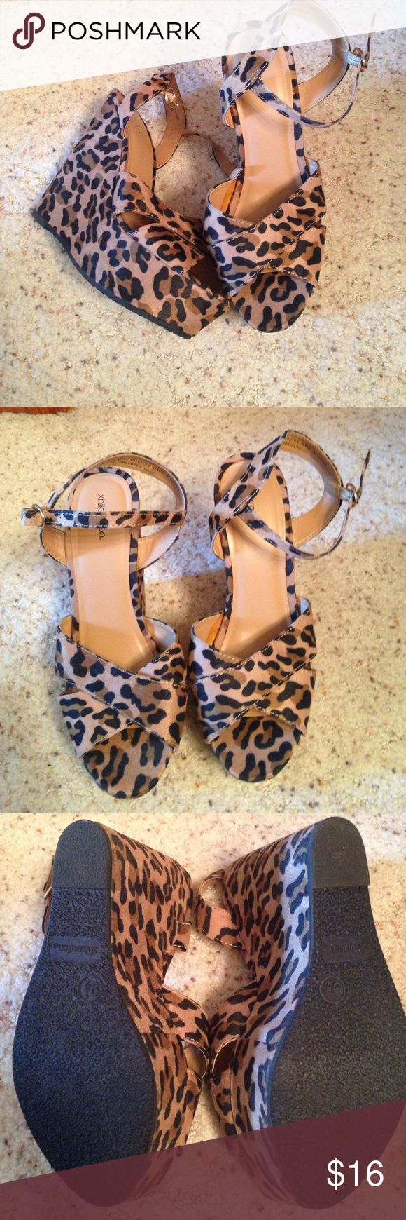 """Leopard print sandals Xhilaration leopard print platform wedges. Like new condition! Comfortable and sexy sandal!! Front platform is 2"""" and heel is 6"""". Xhilaration Shoes Wedges"""