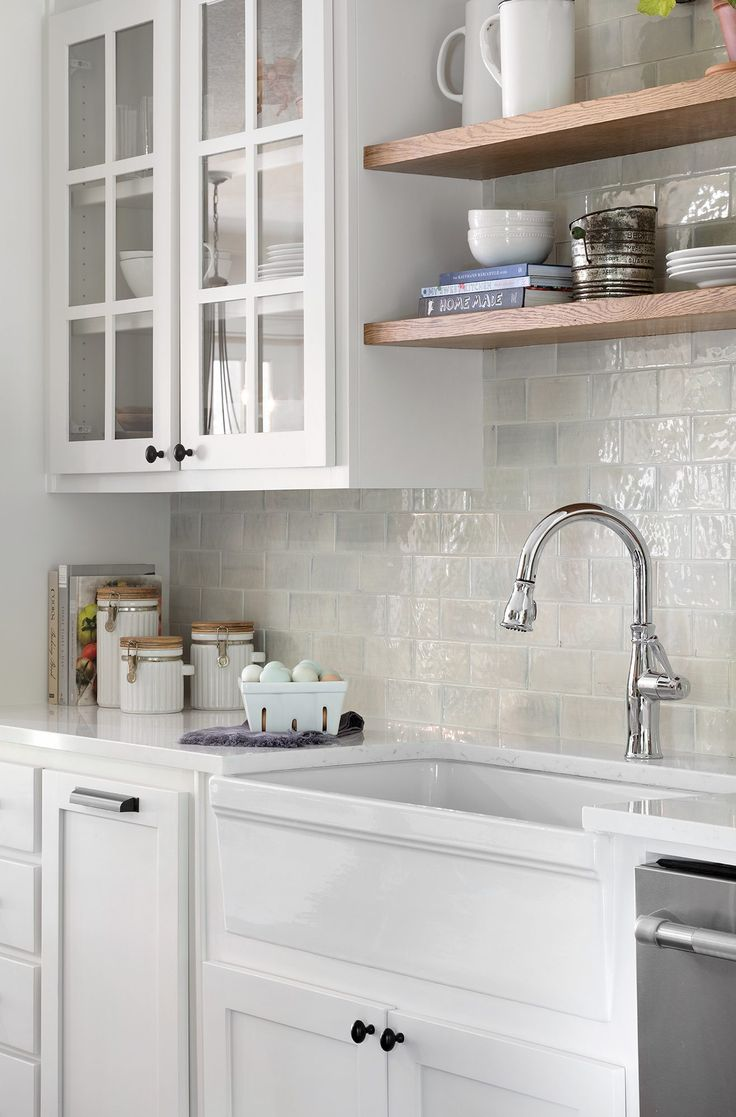 We decided to use a twist on the classic white subway tile in the kitchen with this beautiful ceramic tile. Its shape is a nod to the traditional style of the home, but what I love most is the way its finish reflects the natural light coming into the room.