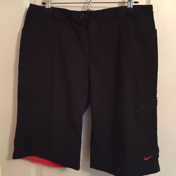 """Nike Stretch Shorts. Great knee length shorts. Black with red stripe down sides. 2 side front pockets with side zippered leg pocket. Worn once in excellent condition. Approx 22"""" long. Nike Shorts"""