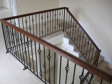 Dark Brown Banister With Wrought Iron Balusters For The