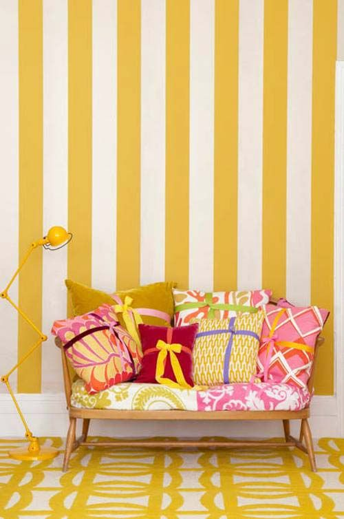 Patterns galore! This room does a very nice job at promoting happiness, yellow can be overpowering, but with the patterns and shades of pink and red it really helps to tone down the yellow.