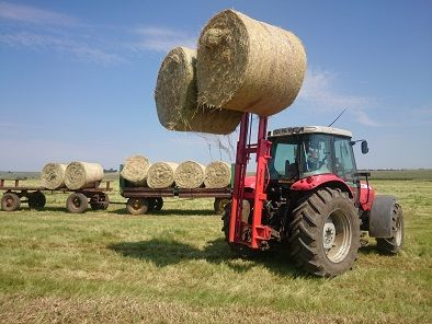 Use your tractor forklift to load round bales.