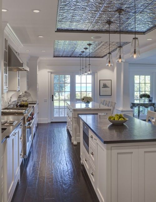 Airoom  Sweet kitchen design with tin ceiling tiles from American Tin Ceiling, white, kitchen island with turned legs with marble countertop, glass pendants, French doors and white counter stools.