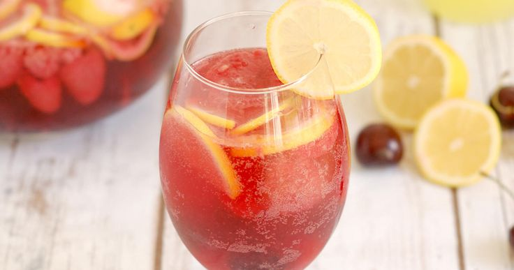 Pink Lemonade Sangria is made with dry rosé wine, fresh lemons, cherries & raspberries. It's finished with a splash of Limoncello! So refreshing!