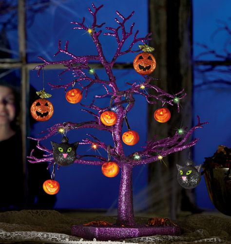 avon s halloween line sparkling halloween tree this creepy centerpiece features 12 hanging ornaments and 12 led lights ornaments include 8 pumpkins