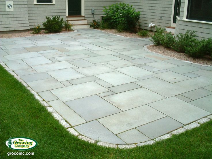 Blue Stone Patio With Stone Edging.