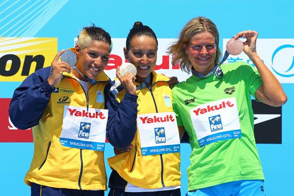 (L-R) Silver medallist Ana Marcela Cunha of Brazil, gold medallist Poliana Okimoto of Brazil and bronze medallist Angela Alexandra Maurer celebrate after the Open Water Swimming Women's 10k race on day four of the 15th FINA World Championships at Moll de la Fusta on July 23, 2013 in Barcelona, Spain.