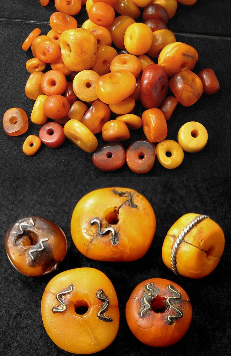 Genuine Amber found in Morocco, posted in Bead Collector dot Net's forum by Uwe   These wonderful examples of repaired amber beads are often far more collectible (and expensive) than the 'perfect' amber beads.