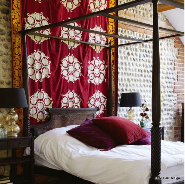 Garnet Red Fabric Provides A Great Detail In This Bohemian Style Bedroom.