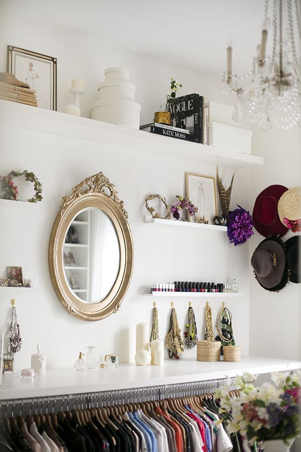 Dream dressing room of Peeptoes blogger Paula Ordovás: An IKEA structure personalized with decorative elements including candles, fashion books, artwork, and a smattering of antiques: