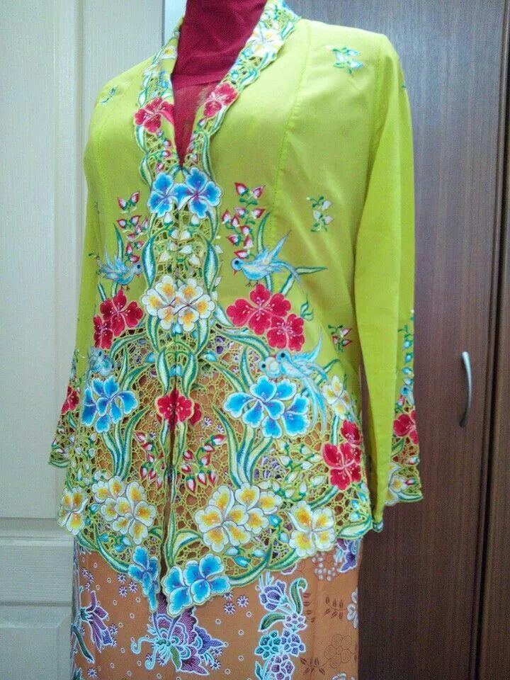 An antique Peranakan  kebaya. ..love the lime green .