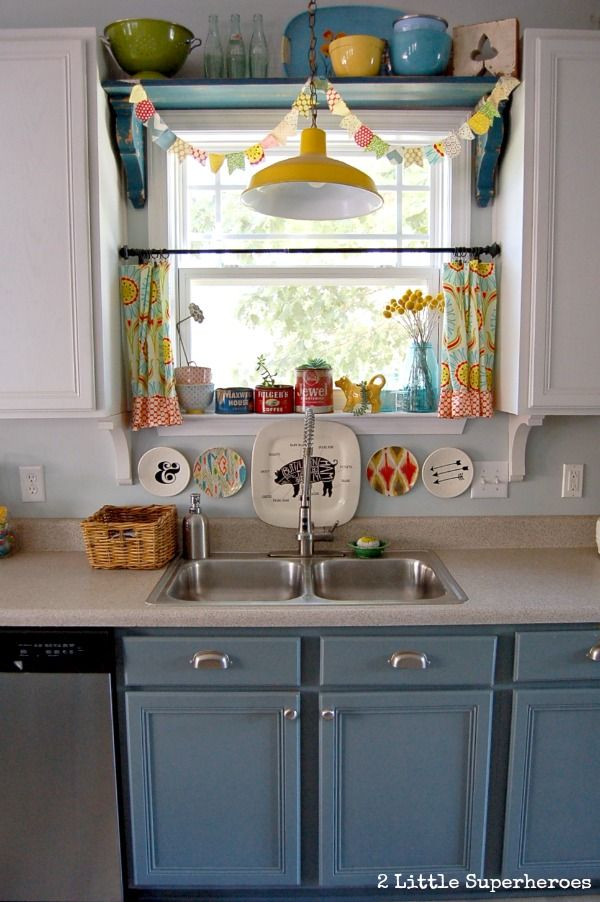 Boring to Blue Kitchen Makeover - love these little curtains!