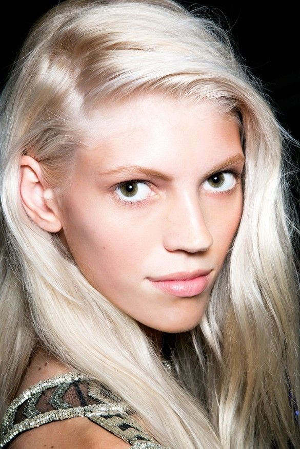 Bright, blonde hair and swept-over side part.