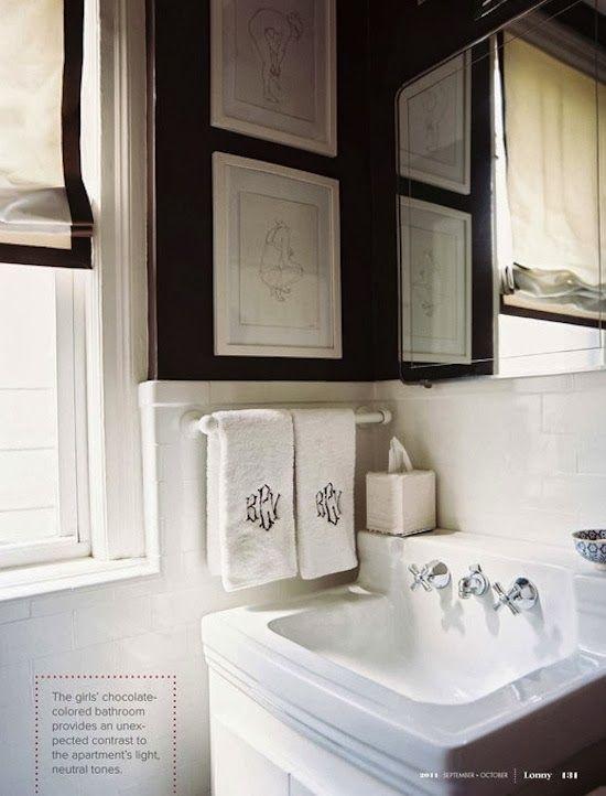 Splendor in the Bath. Monogrammed hand towels and black walls.