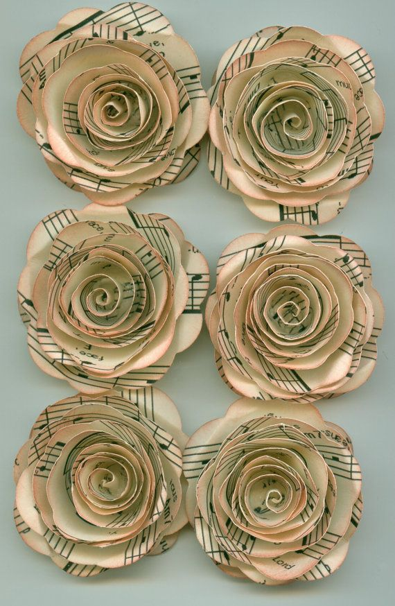 Antique Music Sheet Handmade Large Spiral Paper Flowers. $4.50, via Etsy.
