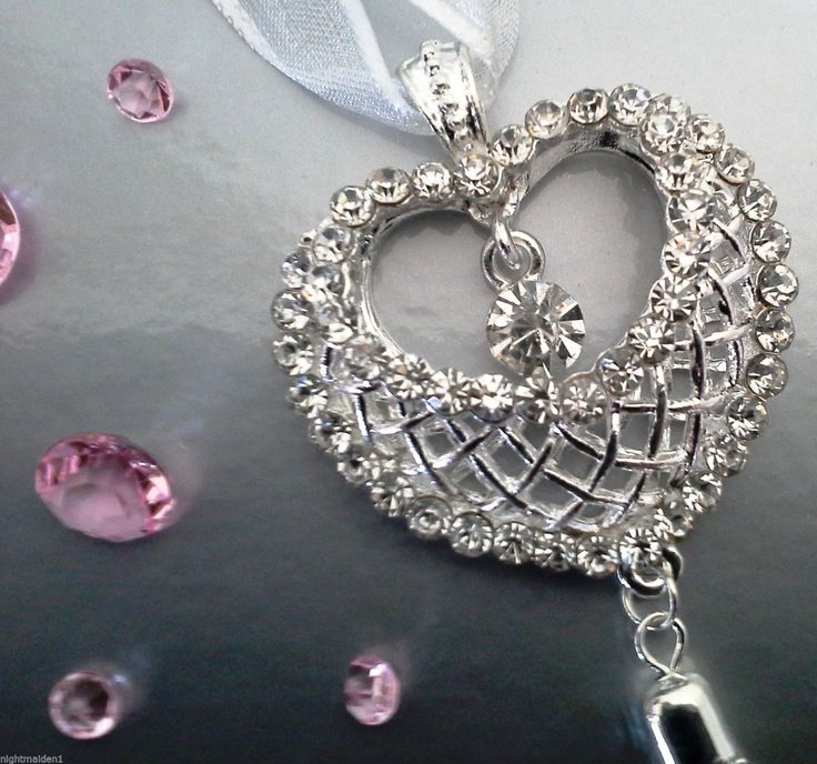 Stunning silver diamante heart keepsake with a silver chains complete with best wishes writable card.