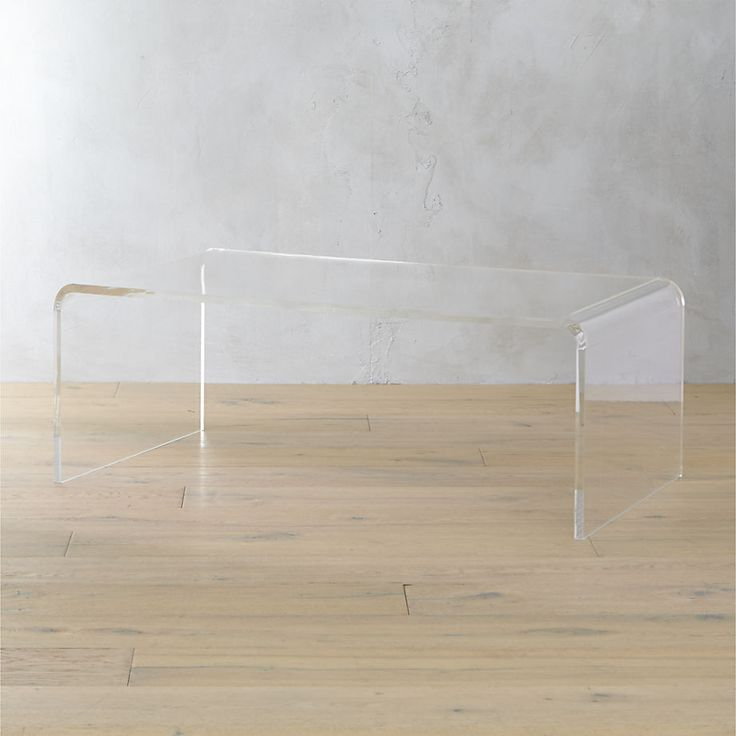 CB2-Lucite Coffee Table.  Pro Tip: Not currently in the budget? Find other items in your budget at a savings and save for this versatile piece. Count those pennies. Soon enough you'll have enough to own it.