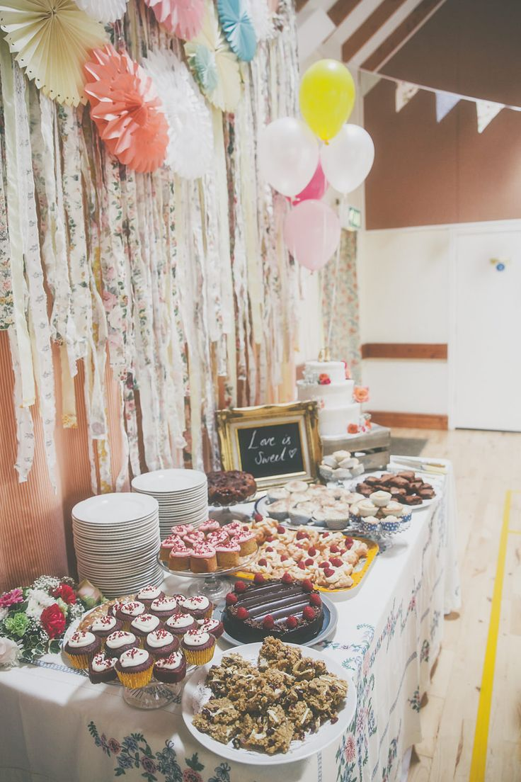 Dessert bar cake table - Image by  Millie Benbow Photography - A Phase Eight wedding dress for a vintage inspired village hall wedding with handpicked wild flowers and floral bridesmaid dresses.