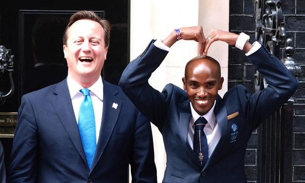 Prime Minister David Cameron with newly crowned double Olympic champion Mo Farah. Two leader...