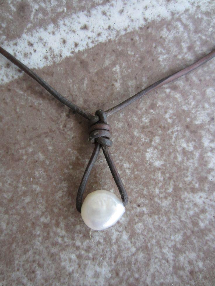 One perfect single baroque pearl leather cord decorative ...