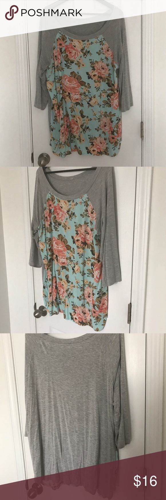 Plus size baseball T shirt with floral front I cut the tag out because it was bothering me but this is an xxl. Slightly longer than regular T-shirt but not quite a tunic. You could potentially wear it with leggings if you were OK with it riding up a little. Tops