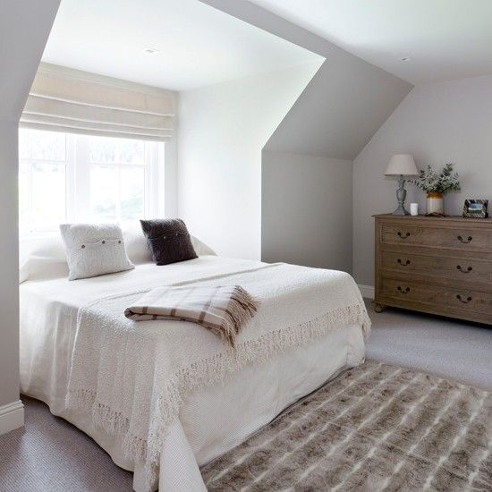 Cosy neutral bedroom with angled roof. Pale colour scheme creates the illusion of space #bedroom #attic