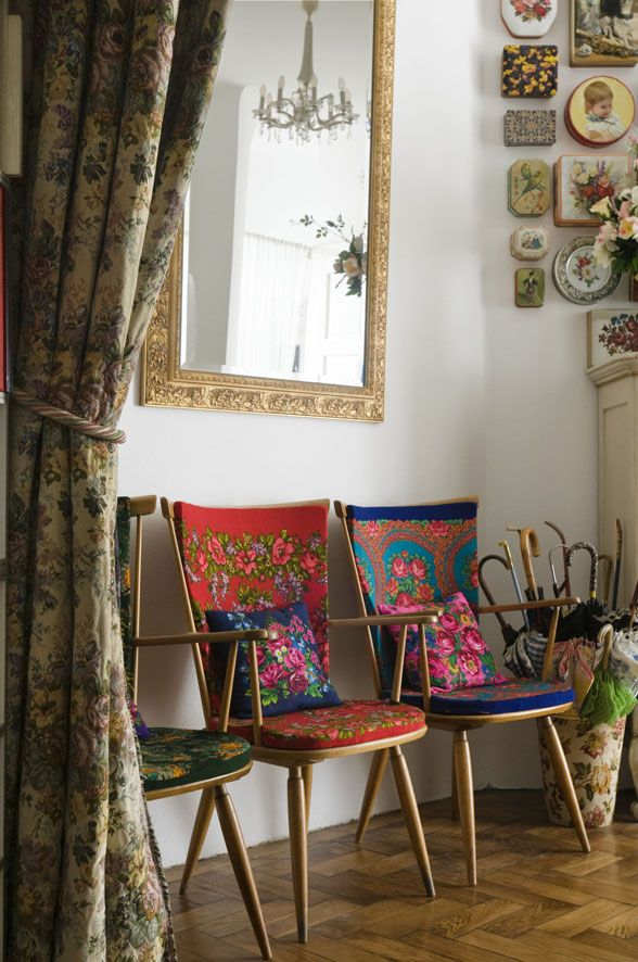 Russian Flowered Textiles - love the idea of three (3) vintage chairs in a row along one of my bedroom walls. Or even in the foyer/mud room.
