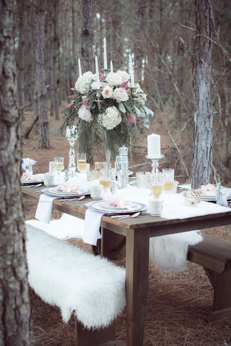 Outdoor Winter Inspired Wedding Reception With Faux Fur And Wooden Farm Tables Tall Blush Pink Ivory Floral Centerpieces