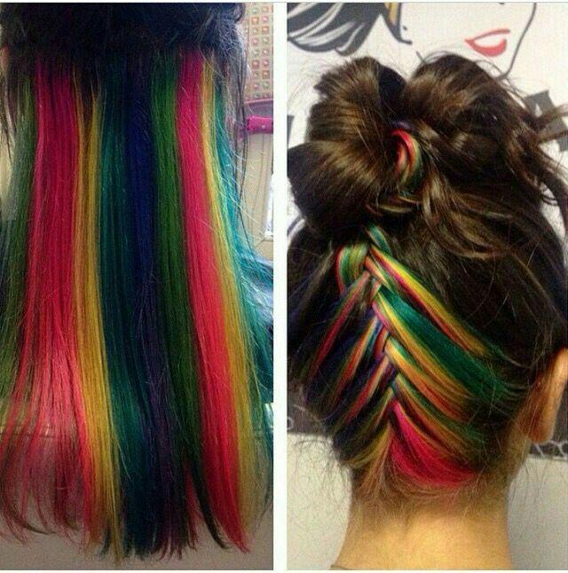 Rainbow hair underneath braided up into a messy bun