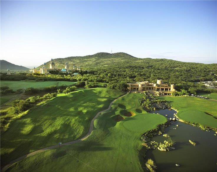 1st hole of the Lost City Golf Course showing The Palace and Clubhouse