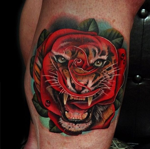 That's One Deadly Flower Tattoo by Andres Acosta #InkedMagazine #rose #morph #tiger #tattoo #art