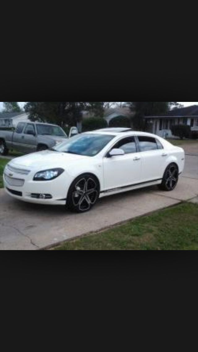 White 2011 Chevrolet Malibu with black rims