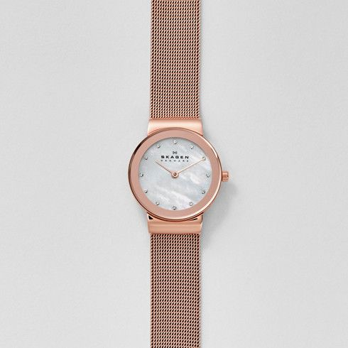 "We designed the Freja Steel Mesh Watch—the name Freja means ""lady"" in Danish—with fresh and understated details. A 26-mm stainless steel case features a mirrored rim. Twelve crystals marking the hours add just the right amount of sparkle to the clean design of the dial, while a sleek stainless steel mesh band adds an additional touch of polish."
