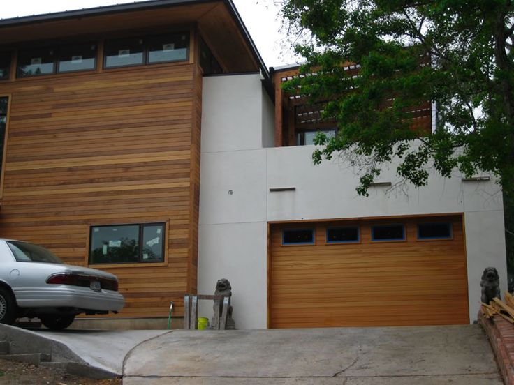 Contemporary Clear Cedar Garage Door installed in Balcones Park  neighborhood of Austin