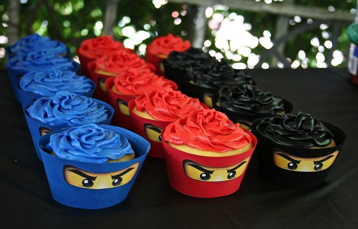 B's Ninjago Birthday Cupcakes. Simply cardstock cupcake liners with glued on ninjago eyes!