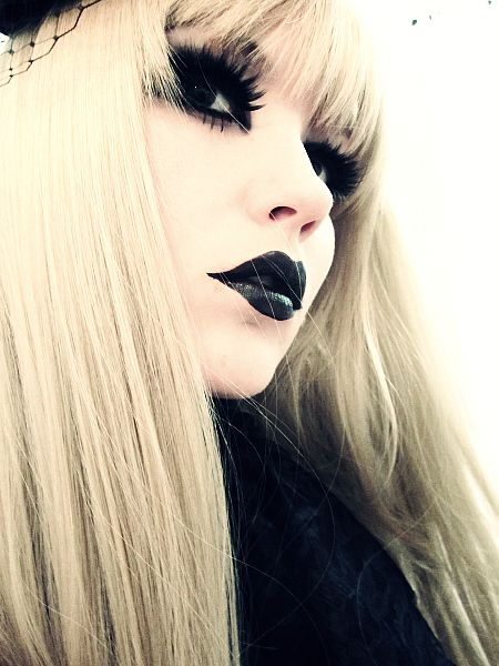 Light hair, white skin and black lips....