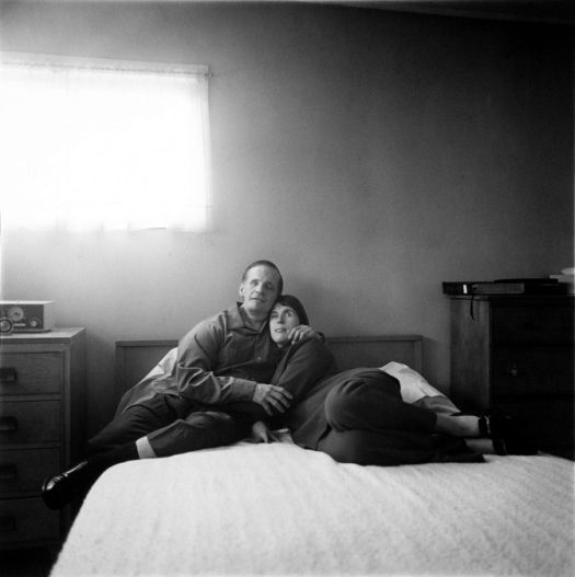 A Blind Couple in Their Bedroom: Diane Arbus. This photo is very well proportioned, the way the couple takes up the whole top bit of the bed. The contrast is balanced, with not too much dark spots or light spots. The light coming through the window is just the right amount of very light tones. This couple looks happy, and the dark spots in the photo aren't too harsh.
