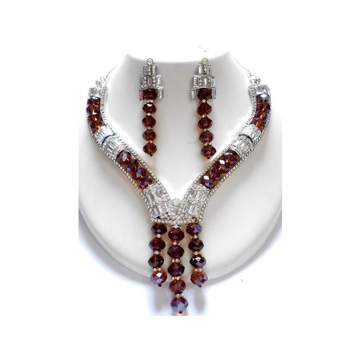 A custom designed CZ Red Stoned Indian Fashion Necklace with a pair of stylish looking matching Fashion Earrings. This necklace can used as Casual / Semi Formal or Formal Party Jewelry Set. It can go any kind of outfits. For more information about Fashion Jewelry or Fashion Necklaces visit at http://skyfashionshop.com/indian-fashion-necklaces/30-rajwadi-jewelry-set.html
