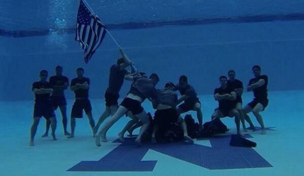 The Navy Men's swimming & diving freshmen recreated the historic flag-raising on the island of Iwo Jima - Photo Source: Navy Swimming & Diving