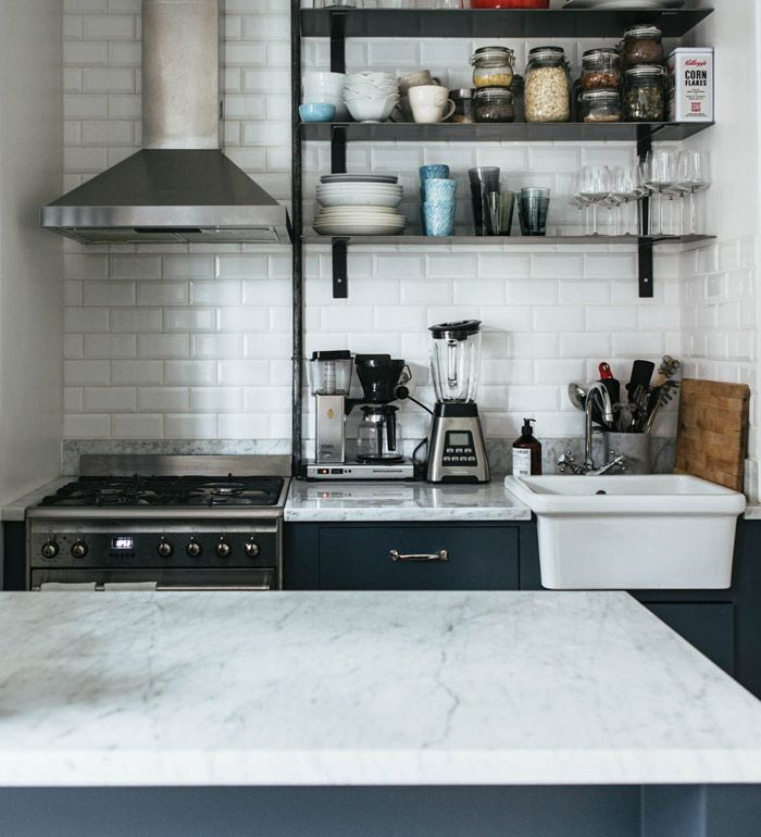 8.  Cozy Industrial The kitchen is the highlight of this small space bachelor pad style flat featuring subway tiling, marble countertops and an adorable Smeg fridge. We also love the open shelving concept which seems to make the space a bit bigger. Via Nooks.se.