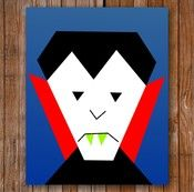 """Vlad the Vegan Vampire is an 8"""" x 10"""" paper pieced quilt pattern, and is a part of the Halloween Quilt of Awesomness Collection.    Isn't he just great for your slightly squeamish friends? He's vegan! He's only coming for your banana hammock!"""