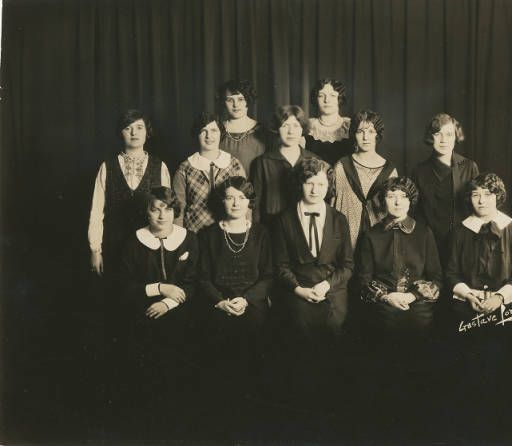 Canary Trills staff 1925- Canary Trills was the first student publication.  Sitting (l to r) are Helen Lucey, Rosemary Martin, Margaret Sennett, Rosemary Seelmann, and Frederica Hall. Standing in the middle (l to r) are Julie O'Connell, Katherine Reynolds, Marion Donohue, Helen Bizak, and Mary Carmody. Standing in the back (l to r) are Katherine Hoey and Marie Kepler.