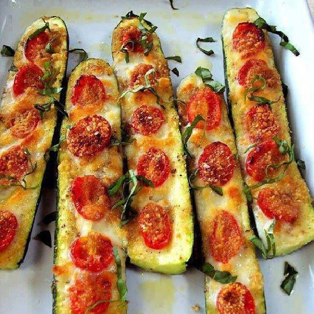 Low carb!...YUMMY!SIMPLE & EASY ... Just my style! Slice the zucchini in half. Slice off the bottom to keep it stable. Brush with olive oil and top with garlic or garlic powder, sliced tomatoes, salt and pepper to taste. Use mozzarella cheese, Parmesan cheese or mixed blend.. Bake 375 for 20 to 30 minutes until soft. ENJOY!