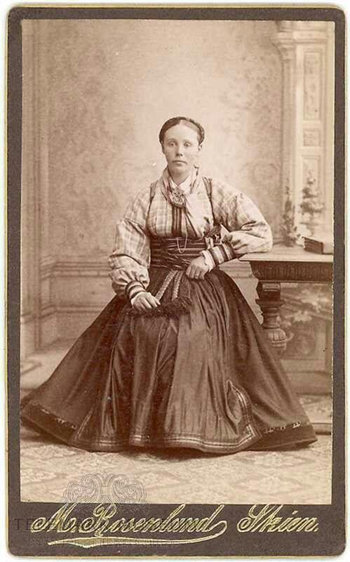 Kvinne i beltestakk rundt 1880