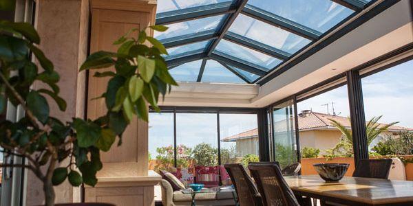 Véranda Grandeur Nature à toiture plate dans l'Hérault (34)